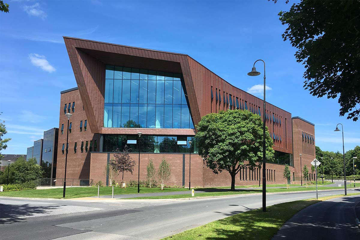 modern style library building with facade and glazed curtain wall