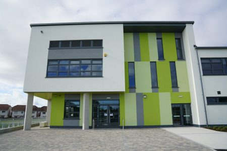 Close up view of the colorful facade system installed for a school